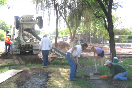 Pouring the footer foundation.